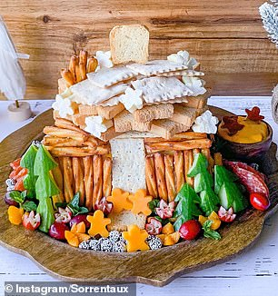 Charcuterie chalets (pictured) are a new twist on the classic holiday food, the gingerbread house