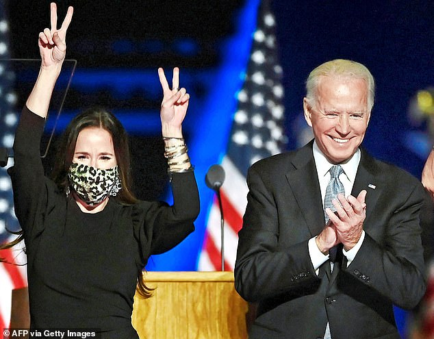 Ashley Biden is pictured above with Joe Biden.  One Washington insider said last night: 'Until now, Ashley has not been on the radar because she's never been ready or willing to step into the spotlight. 'When Joe was vice president under Barack Obama, she had some issues and so was content to keep her head firmly below the parapet'