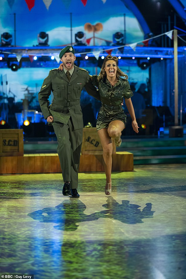 Presenter JJ Chalmers and Amy Dowden donned a military costume as he danced with his partner Amy Dowden (pictured)
