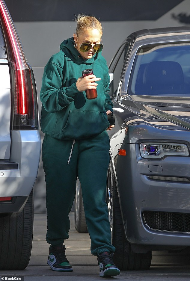 Fly girl: The Selena star, 51, sported truly fly extra-large sunglasses that covered half her face