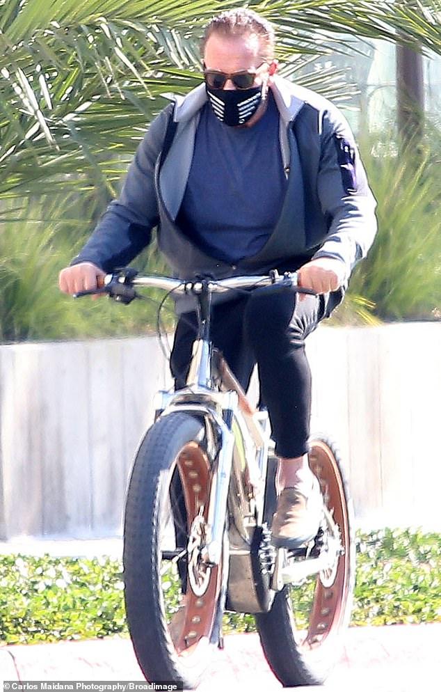 Arnold Schwarzenegger, 73, stays action star fit on bike ride with girlfriend Heather Milligan, 46