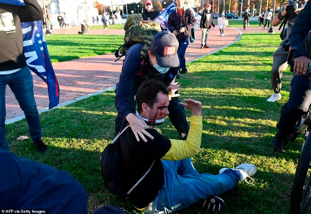 A bystander rushed to assist the injured man as police with bicycles set up a perimeter around him