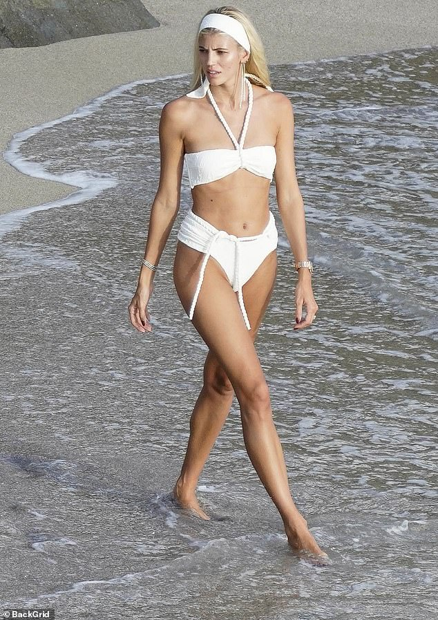 Stunning: Devon paired her stappy bikini with a white headband and golden jewellery and she let her natural beauty shine through as she decided to go make-up free