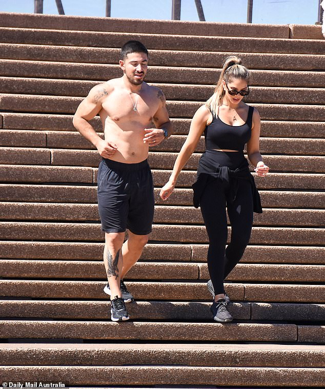 Working up a sweat! Celebrity fitness trainer Jono Castano, 29, (left) and his model wife Amy, 30, (right) were spotted working out at the Sydney Opera House on Sunday