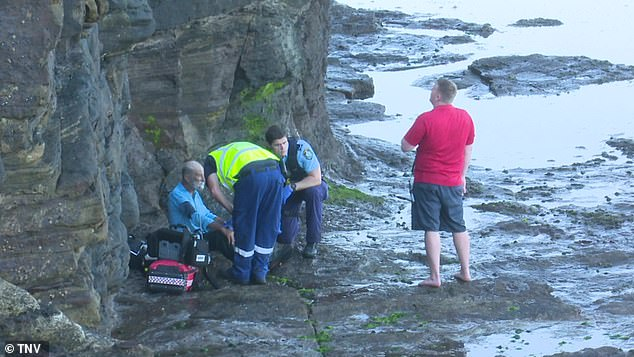 A paraglider has survived (pictured) after crashing into the ocean off the coast of Sydney