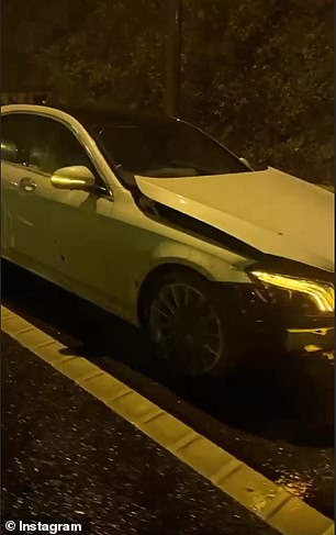 Mr Khan took video footage at the scene of the crash which showed his front bumper hanging off while his hazard lights blinked as he waited for assistance