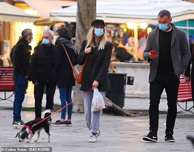 Cute: The couple, who have been linked since 2017, brought their newly adopted dog Scout to the Venetian market with them