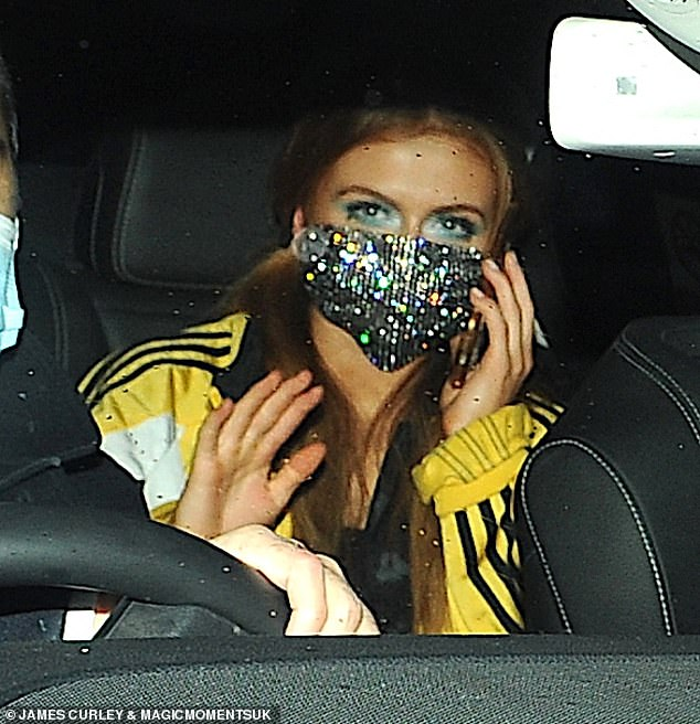 Dazzling: The EastEnders star, 19, still managed to stand out in a silver sequinned face mask as BBC bosses placed a ban on after-p1 arties during the coronavirus pandemic