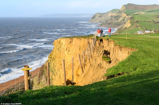 The collapse of a cliff along the Jurassic Coast has taken part of the holiday park camping field with the boundary fence hanging in the air