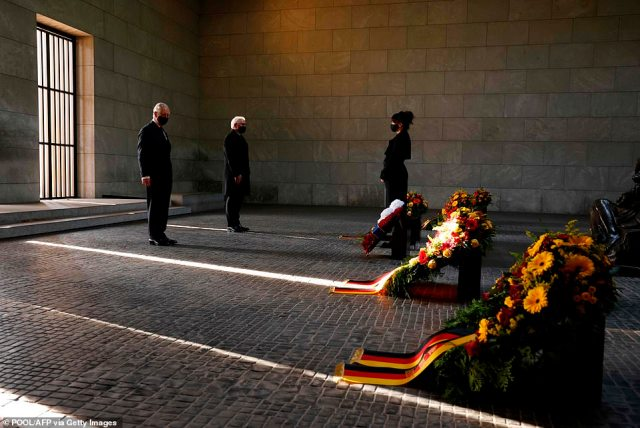 Prince Charles, Prince of Wales (L) and German President Frank-Walter Steinmeier (C) pay their respect during a wreath laying ceremony on national Memorial Day