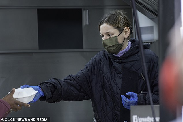 The Crown's Princess Diana actress Emma Corrin hands out meals at a food bank