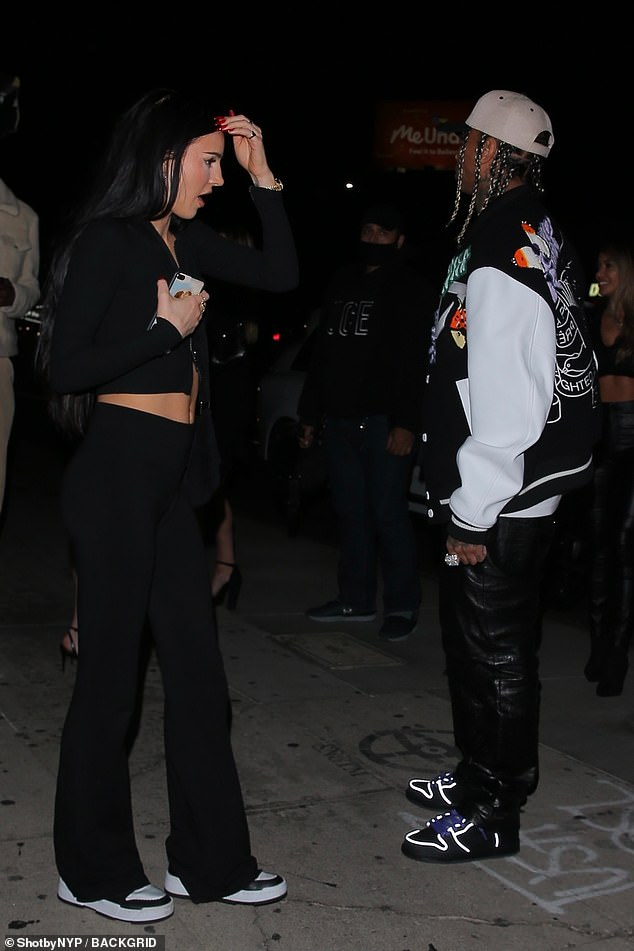 Fine dining: Tyga wore a bomber jacket as he stepped out for dinner with the raven-haired beauty, Genelle Seldon, at Nice Guy in West Hollywood on Saturday