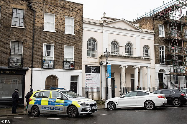 Police officers have stopped an evangelical church from holding a baptism service in breach of the national coronavirus lockdown restrictions (pictured, police cars outside the church)