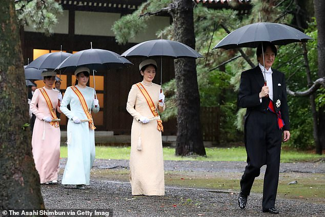 Princess Mako (in blue)has taken on a more active role within the family in the months since her uncle was made Emperor and her father heir to the throne in May. Pictured left to right: Princess Kako, 24, and Princess Mako with parents Crown Princess Kiko and Crown Prince Fumihito in October 2019