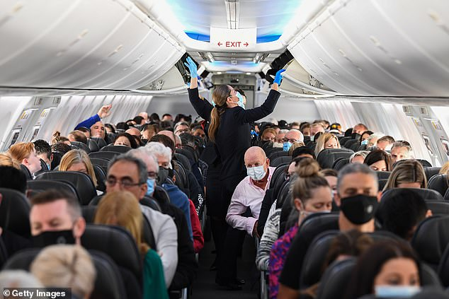 Passengers who flew from Adelaide to Perth on Sunday were told to quarantine or go home. News of Adelaide's outbreak came as their plane was in mid-air. Pictured: a Qantas flight to Adelaide last month