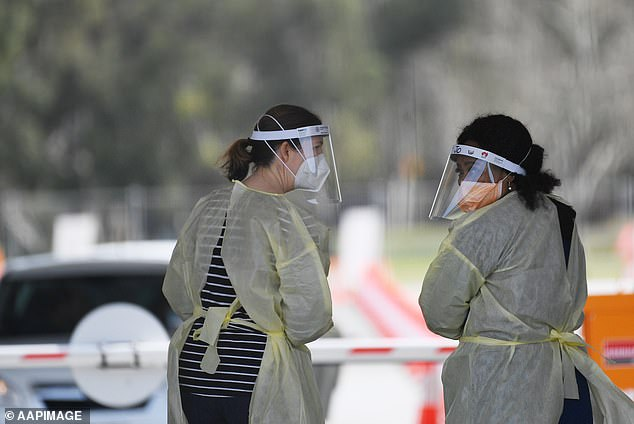 Medical staff at an Adelaide coronavirus testing clinic in September. Adelaide's spiralling outbreak is worrying health authorities