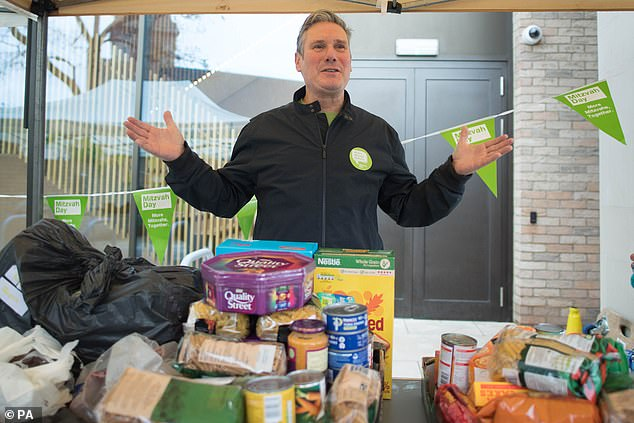 Sir Keir (pictured distributing food parcels at South Hampstead Synagogue today) gave an insight into his younger days as he become the latest senior politician to brave the Radio 4's Desert Island Discs