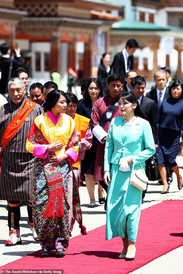 In July the Crown Prince said he did not know whether his daughter's marriage will take place. Pictured,Princess Mako being welcomed by Princess Eeuphelma Choden Wangchuck in Bhutan 2017