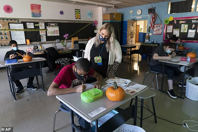 As a result, nearly 1,100 classrooms (pictured October 15) have gone through temporary closures. At least 115 school buildings have been closed for 24 hours because of positive tests; 62 have been closed for 14 days or more