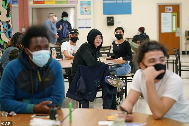 Since the start of the school year, 1,800 students (pictured on October 29) or staff in the system have tested positive for the virus