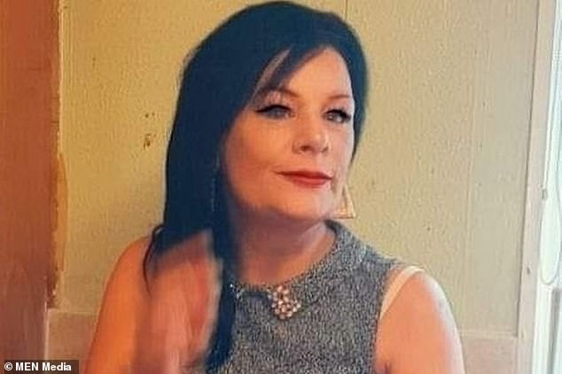 Julie Ainsley's body was found in a wooded area off Williams Road in Motson, Manchester, following reports of a person on fire on Saturday evening. The 48-year-old is pictured
