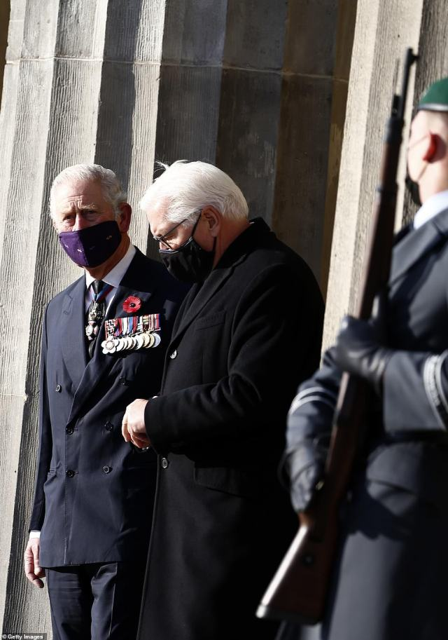 Charles, pictured wearing his military medals, and President Frank-Walter Steinmeier leave after they laid wreathes at the Neue Wache memorial