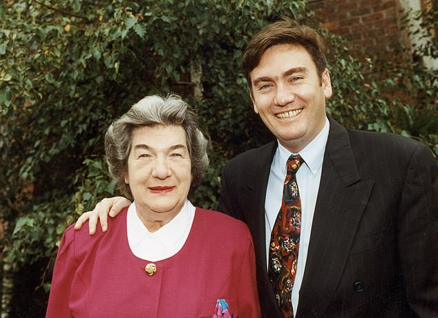 Family: It comes after Eddie told the Herald Sun on Friday that his mother Bridie's death in August had made him reflect on what matters most - leading to his decision to step down from Triple M Melbourne's top-rating Hot Breakfast show. Pictured: Eddie and his mother in 1993