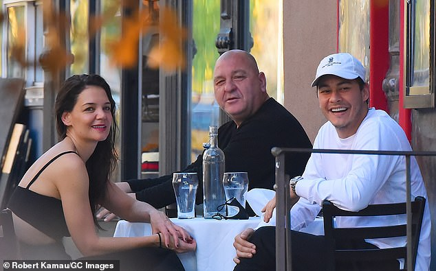 Family business: Missing from The Secret Dare to Dream actress' side on Sunday was her boyfriend Emilio Vitolo Jr. (R), who works in the kitchen of his father's (M) Italian restaurant Emilio's Ballata (pictured last Tuesday)