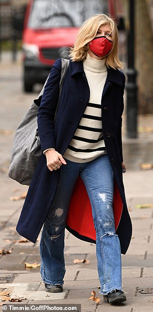 Sighting: The presenter, 53, looked pensive as she strolled to work at her radio show while clad in a cream jumper with black stripes, paired with ripped jeans