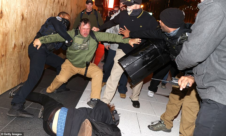 DC police officers grapple with protesters as violence erupts in Washington D.C. on Saturday night