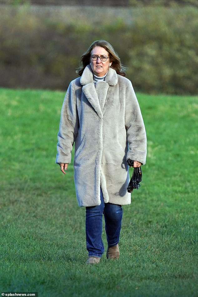 Keeping warm: The politician, 57, wrapped up against the chilly climes in a fluffy grey coat as she treated herself to some fresh air amid the UK's second coronavirus lockdown