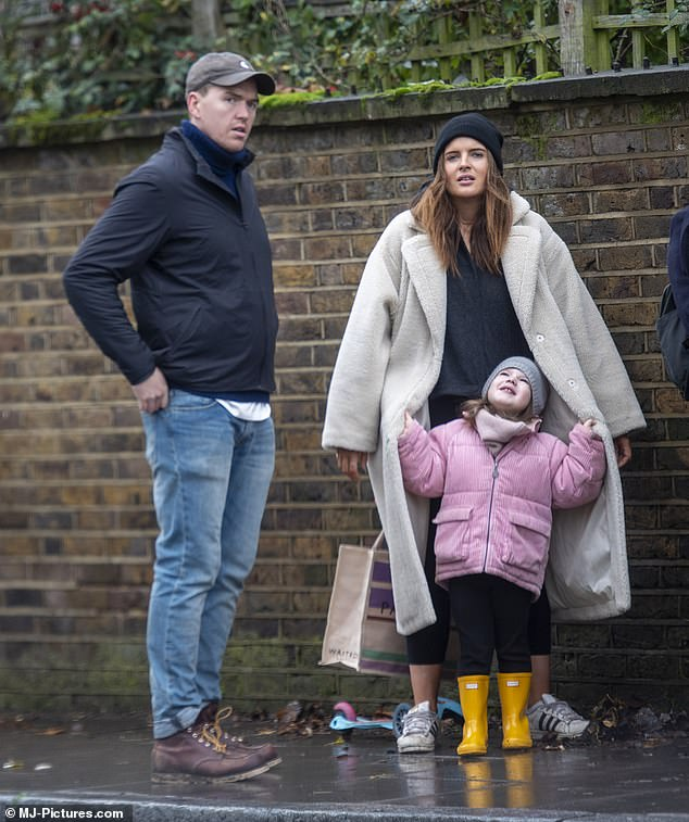 Family:Binky Felstead looked delighted as she enjoyed some quality time with daughter India, three, and fiancé Max Darnton on Sunday