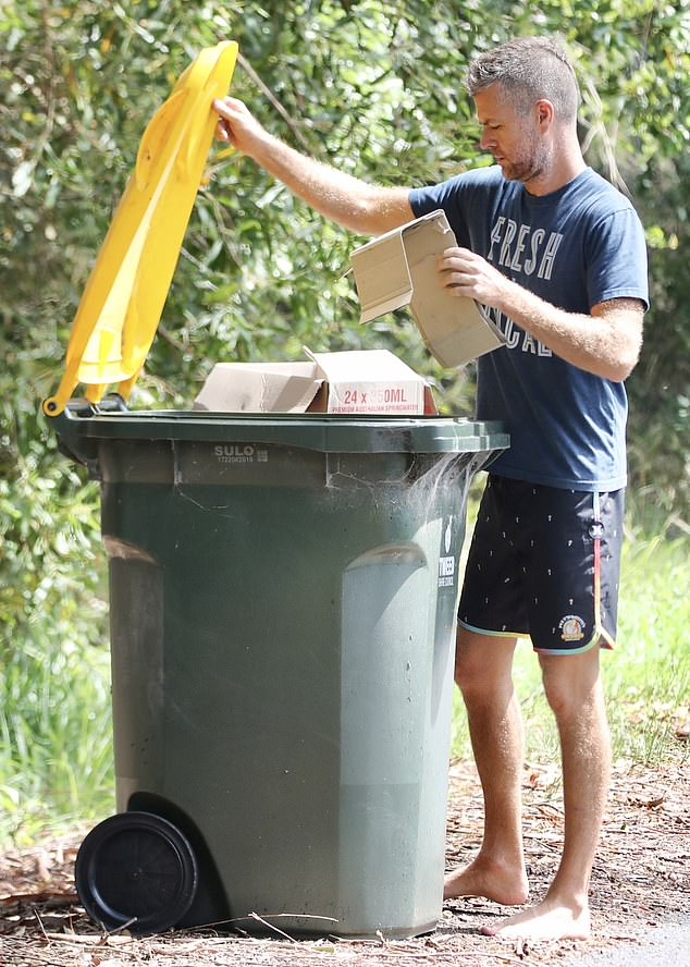 Binned:Pete carefully unfurled the boxes and placed them inside, before pushing the wheelie bin further down the road