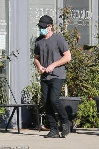 Sam Worthington wears a face mask as he steps out in Hollywood