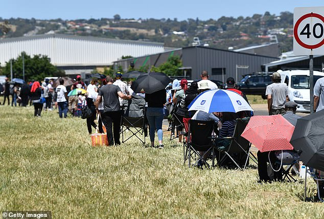 The emerging cluster - linked to a family in Adelaide's north - has prompted the state government to reimpose a range of coronavirus restrictions. Pictured: Residents queueat the Parafield Gardens testing centre on Tuesday