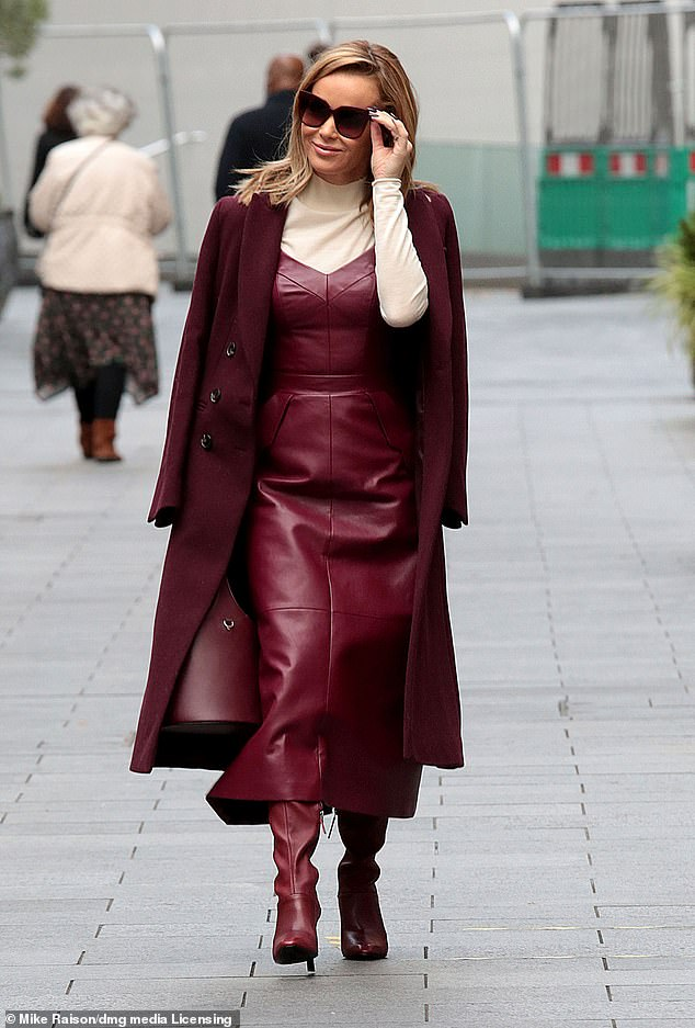 Looking good: Amanda Holden commanded attention once again as she left Heart FM studios after hosting the station's breakfast show on Tuesday morning