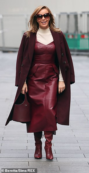 Impressive:She boasts an eye-catching work wardrobe that most women can only dream of