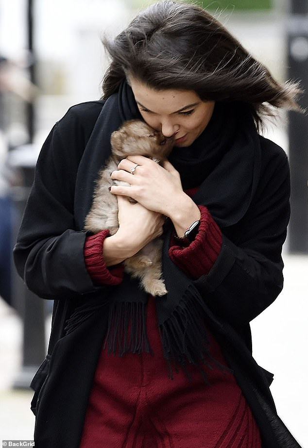 Delightful! The former Coronation Street actress, 33, looked smitten with the new addition to her family as she walked through the city and shielded him from the chilly November weather