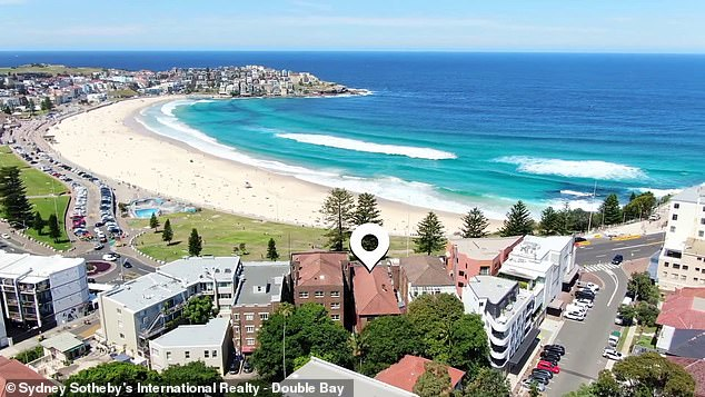 The block of four two bedroom units above Trio restaurant (pictured centre) on Australia's most famous beach are being offered for $12million