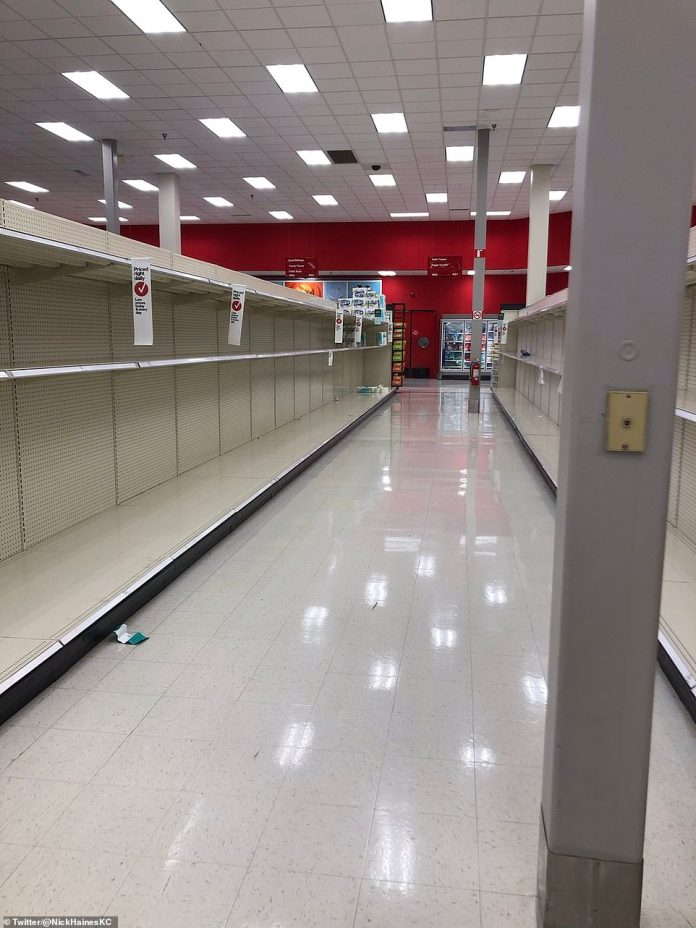 Target, Kansas City: Companies like Walmart, Target and Wegman's may have to curb their hours so staff can restock the shelves in similar scenes to earlier this year. Staff in this Kansas target are already seeing empty shelves