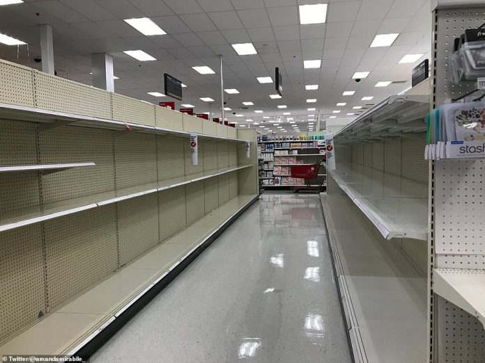 New York: As governors acted there were local reports of panic buying beginning in stores across the country. A picture taken on Saturday shows more empty shelves