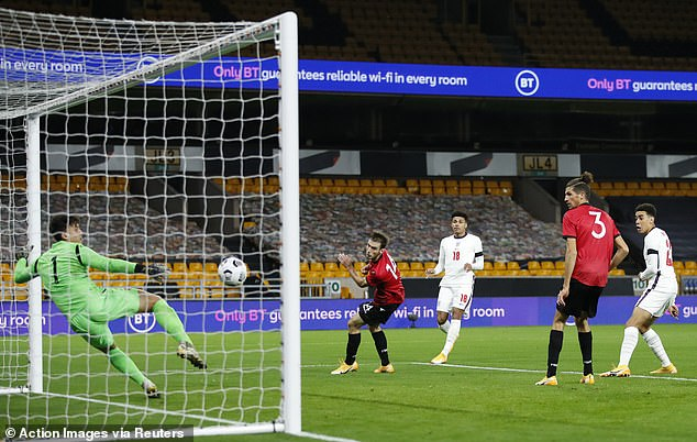 Leicester defender James Justin snuck in at the back post to score England's second goal