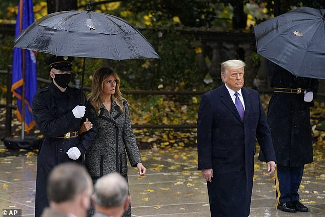 President Donald Trump (right) and first lady Melania Trump (left) also marked Veterans Day on Wednesday, voyaging to Arlington National Cemetery
