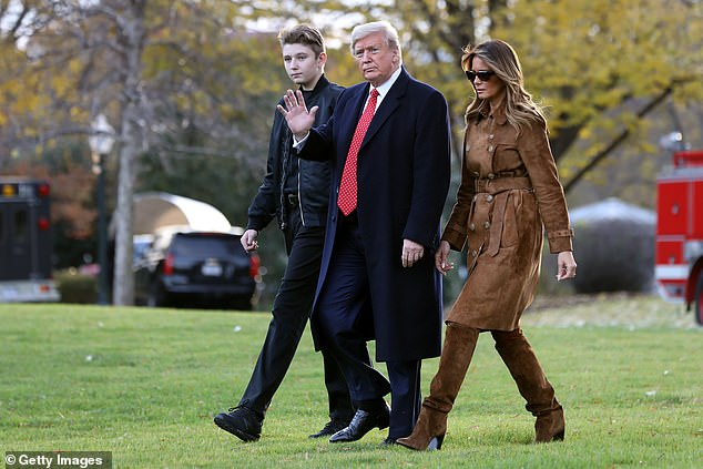 Barron Trump (left), President Donald Trump (center) and first lady Melania Trump (right) walk across the White House's South Lawn en route to Mar-a-Lago in 2019 to celebrate the Thanksgiving holiday