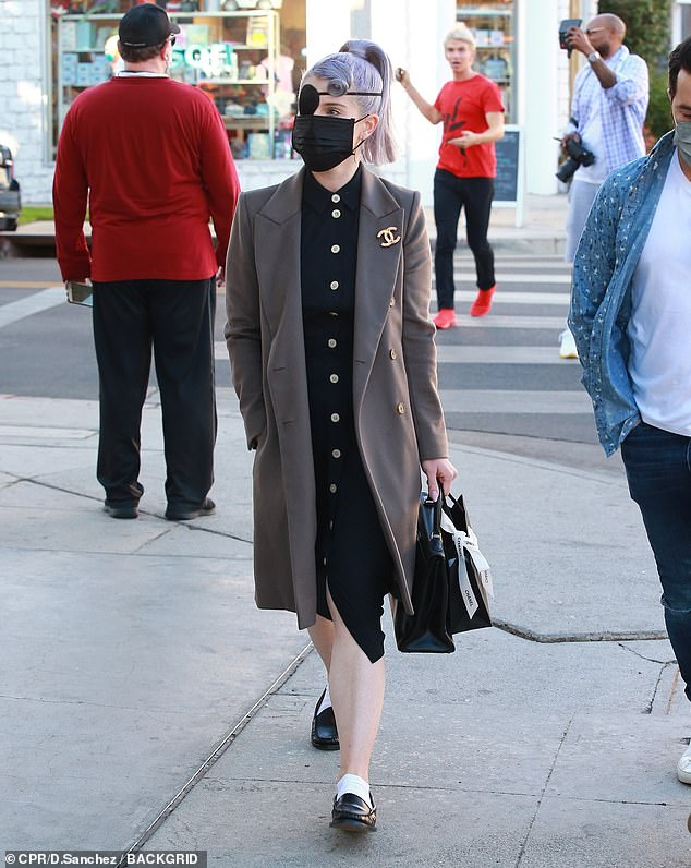 Vintage:Kelly layered up her look with a vintage coat that had a stunning Chanel broach attached to one of her lapels