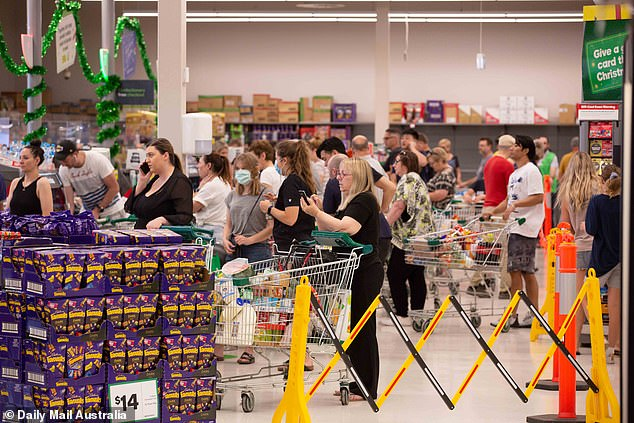 Panic buying begins: Shoppers flocked to the supermarket after six-day lockdown was announced on Wednesday
