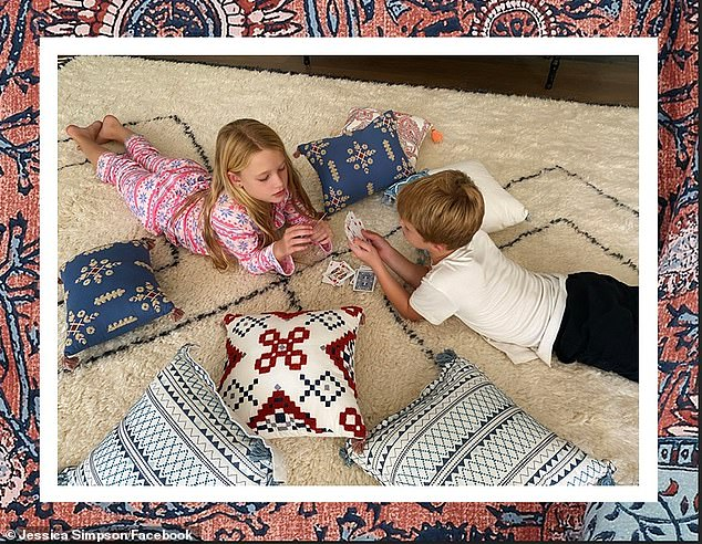 'We're snugging in for a winter at home!' The platinum-blonde Texan also recently used her eight-year-old daughter Maxwell Drew and seven-year-old son Ace Knute in an advertisement for Jessica Simpson Home decorative pillows (posted Tuesday)