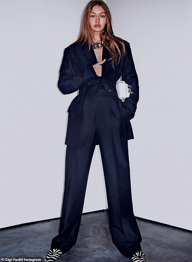 Suits her!Gigi Hadid was dressed to kill in several throwback snaps she posted from her Alexander Wang shoot on Wednesday