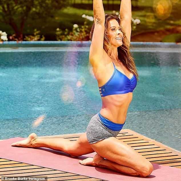Stretch: Brooke Burke admitted during an interview with Fox News that it's 'easier' to maintain her physique in her 40s because she 'understands' her body; seen on Instagram