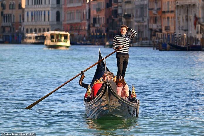 Sail away: Riccardo brushed his dark locks of his face while navigating the waters